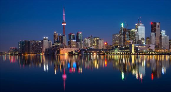 Toronto skyline against reflection of water.